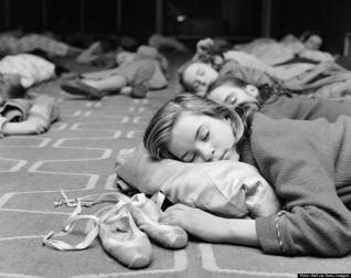 28th December 1961: Twelve-year-old Suzanne Cullingford keeps one hand on her ballet slippers during a nap at the Royal Festival Hall in London. She and the other young members of the Festival Ballet have been ordered to take a nap between performances of Tchaikovsky's 'Nutcracker Suite'. (Photo by Peter Hall/Keystone Features/Getty Images)