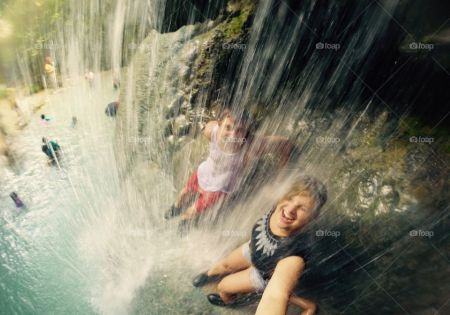 children-playing-in-waterfall